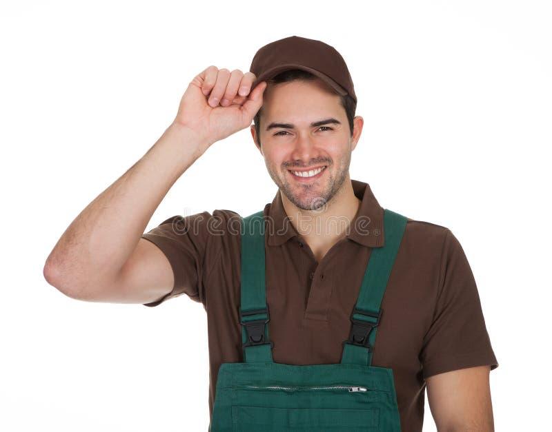 Glücklicher junger Gärtner in den Dungarees lizenzfreies stockbild