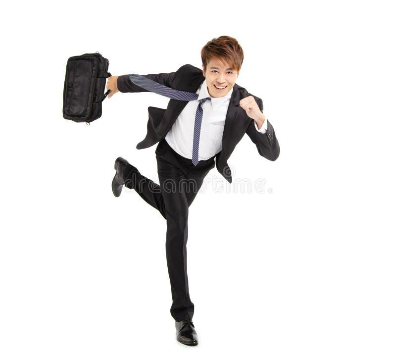 Glücklicher junger Geschäftsmannbetrieb lizenzfreie stockbilder
