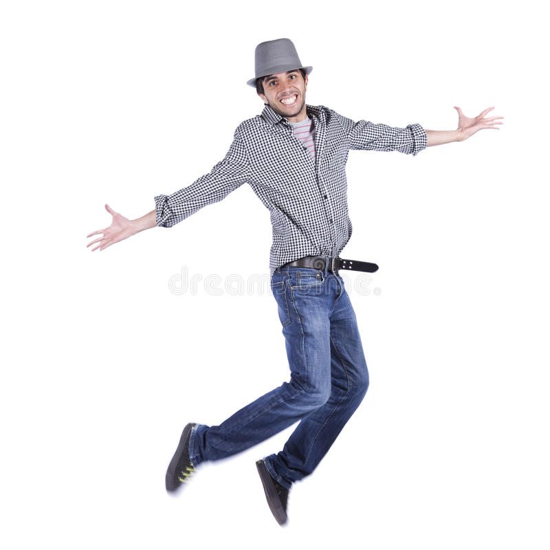 Glücklicher junger Mann springen stockbild