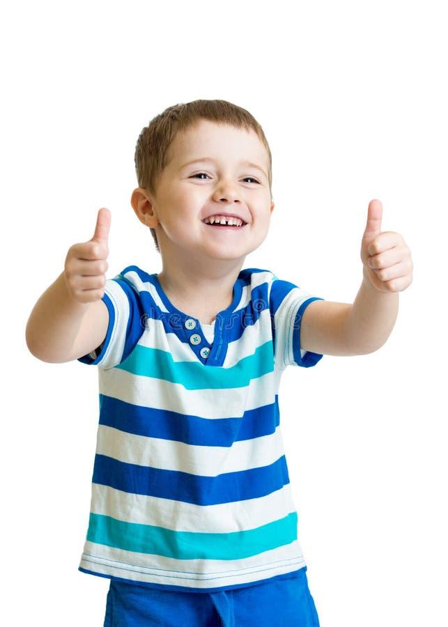 Glücklicher Kinderjunge mit den Handdaumen oben stockfotografie