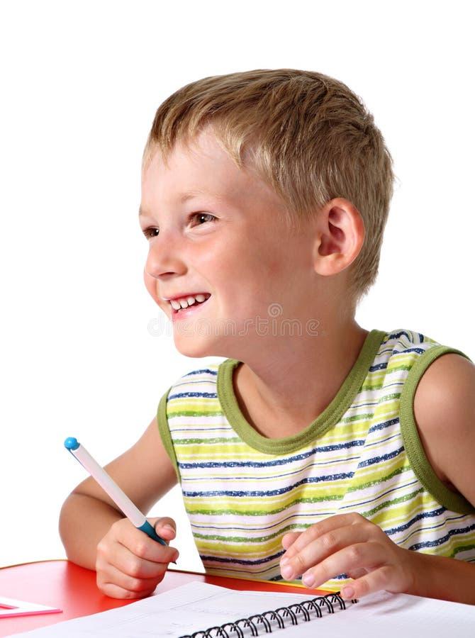 Glücklicher kleiner Schulejunge lizenzfreie stockbilder