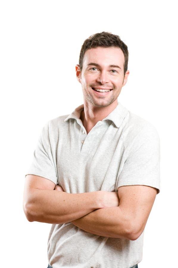 Glücklicher lächelnder junger Mann stockbilder