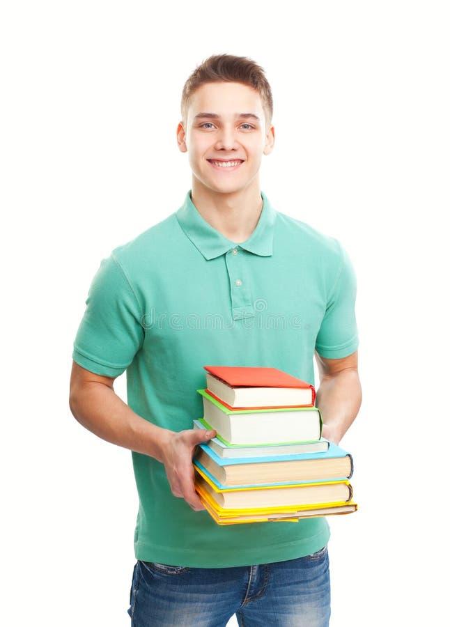Glücklicher lächelnder Studentenholdingstapel Bücher lokalisiert auf Weiß stockbilder