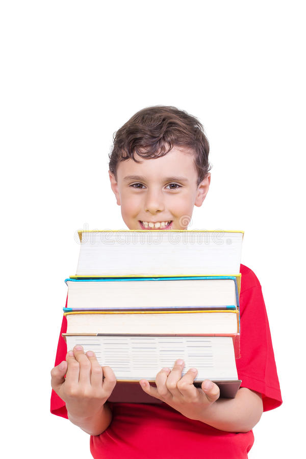Glücklicher lächelnder tragender Haufen des Jungen von Büchern lizenzfreies stockfoto