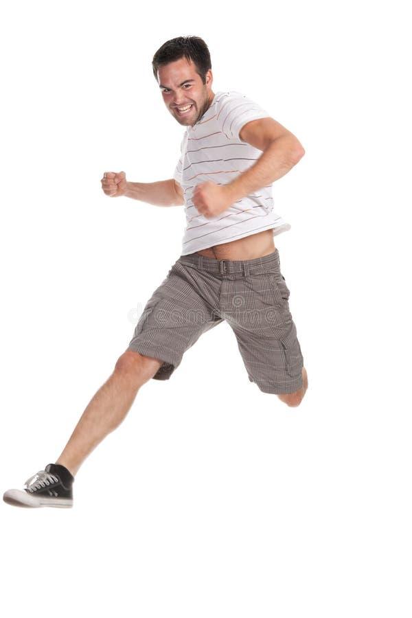 Glücklicher Mann, der auf einen weißen Hintergrund springt lizenzfreies stockbild