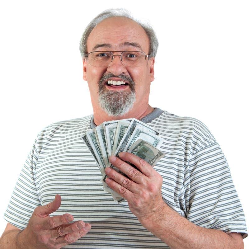 Glücklicher Mann mit der Hand voll vom Geld stockfotografie