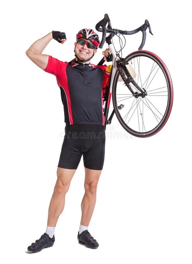 Glücklicher Radfahrer trägt ein Fahrrad stockbilder