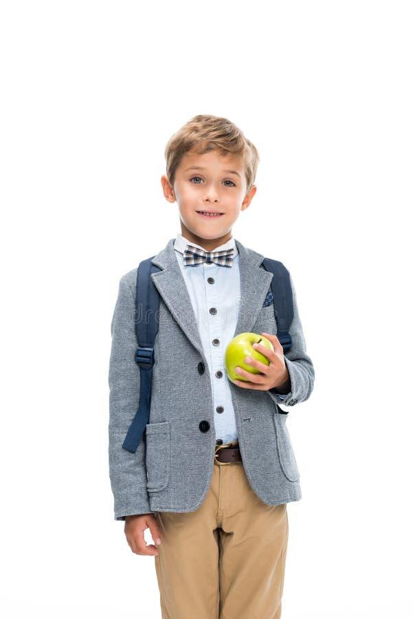 Glücklicher Schüler mit Apfel stockfotografie
