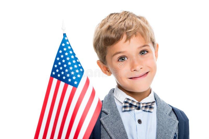 Glücklicher Schüler mit USA-Flagge lizenzfreie stockfotos
