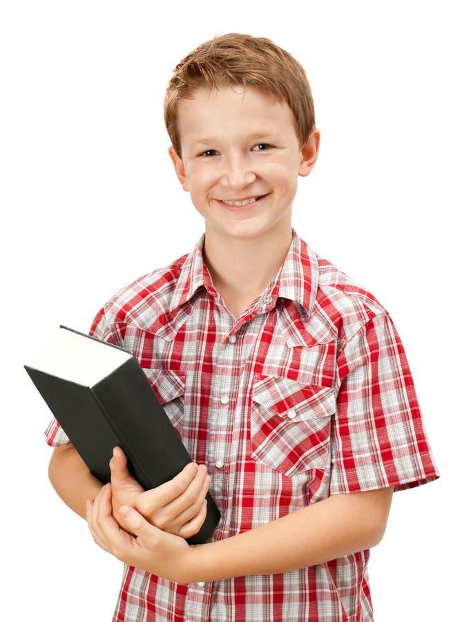 Glücklicher Schulejunge stockfoto
