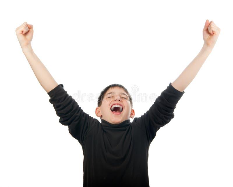 Glücklicher Teenager mit den Händen in der Luft schreiend stockbilder