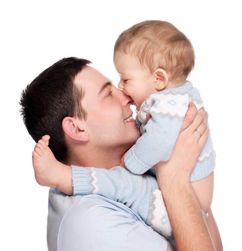 Glücklicher Vater mit einem Schätzchen getrennt auf einem Weiß stockbild