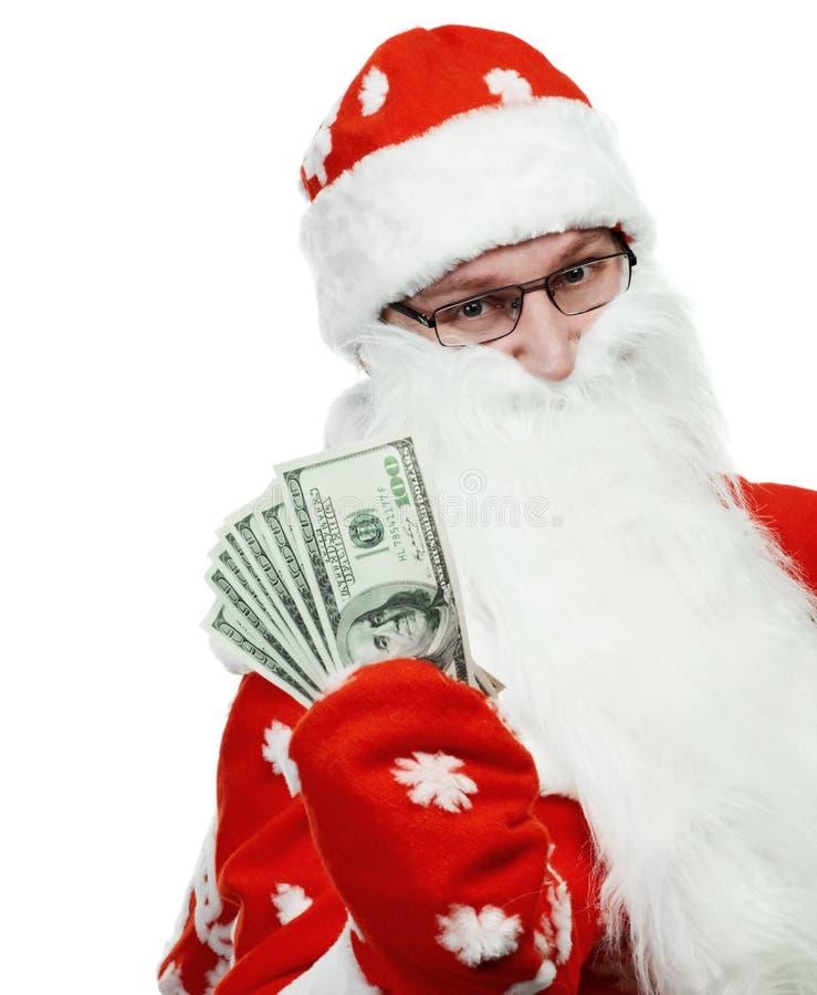 Glücklicher Weihnachtsmann im roten Hut mit Dollargeld lizenzfreies stockbild