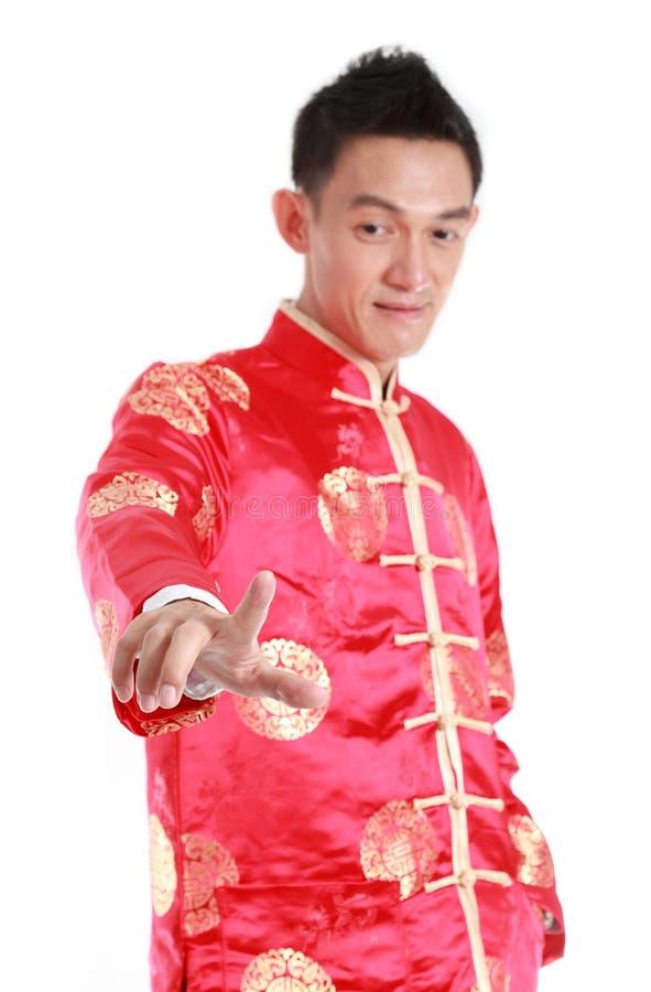 Glückliches asiatisches chinesisches Handpressen des neuen Jahres auf weißen Hintergrund lizenzfreies stockbild