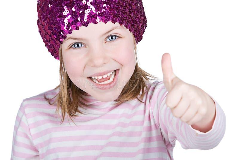 Glückliches blondes Kind mit ihrem Daumen oben stockbilder