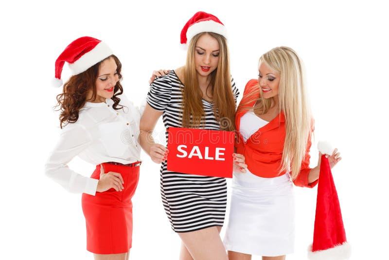 Glückliches Einkaufenmädchen auf weißem Hintergrund lizenzfreie stockfotos