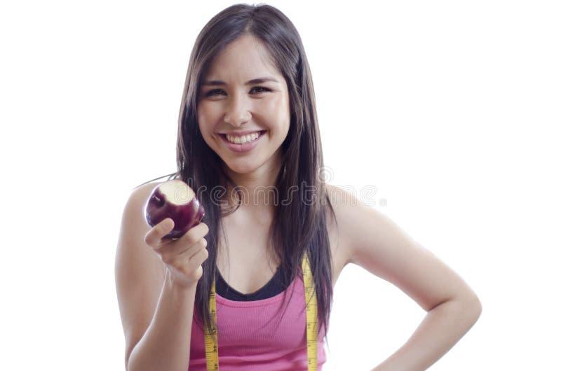 Glückliches Frauenessen gesund lizenzfreie stockbilder
