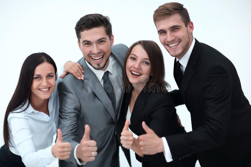 Glückliches Geschäftsteam, das sich Daumen zeigt I stockbild