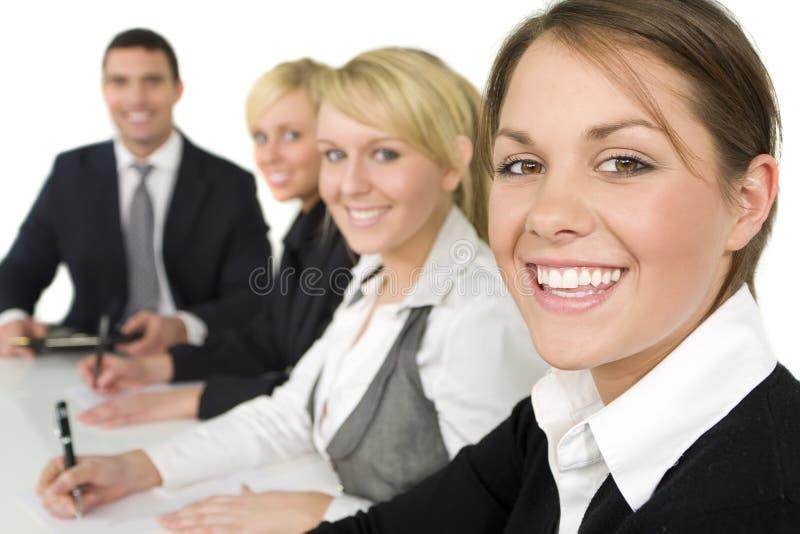 Glückliches Geschäftstreffen stockfoto