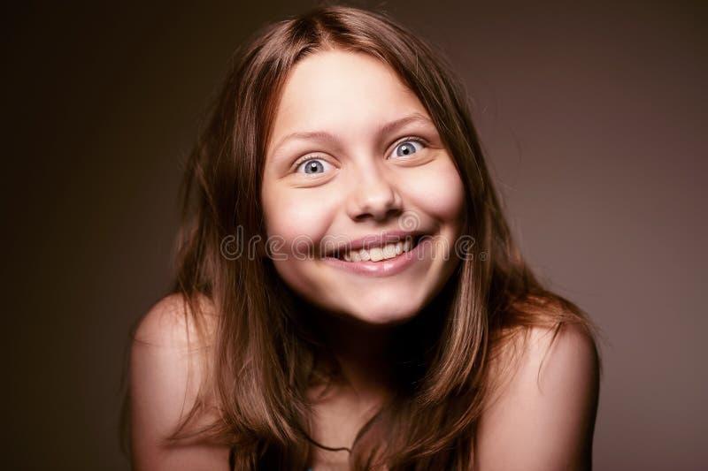 Glückliches jugendlich Mädchen stockfoto