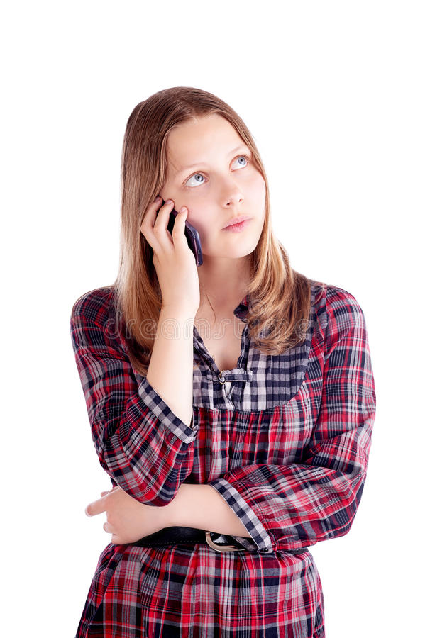 Glückliches jugendlich Mädchen, das am Handy spricht stockfoto