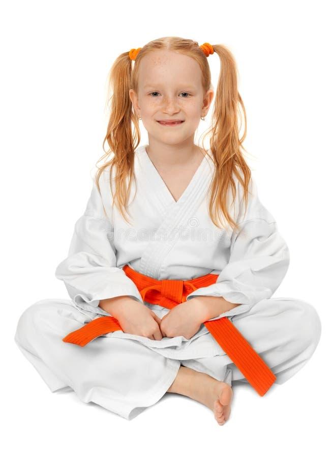 Glückliches Karatemädchen stockfotos