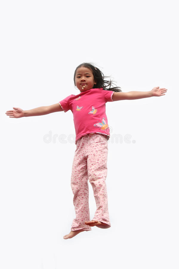 Glückliches Kind springen lizenzfreies stockfoto