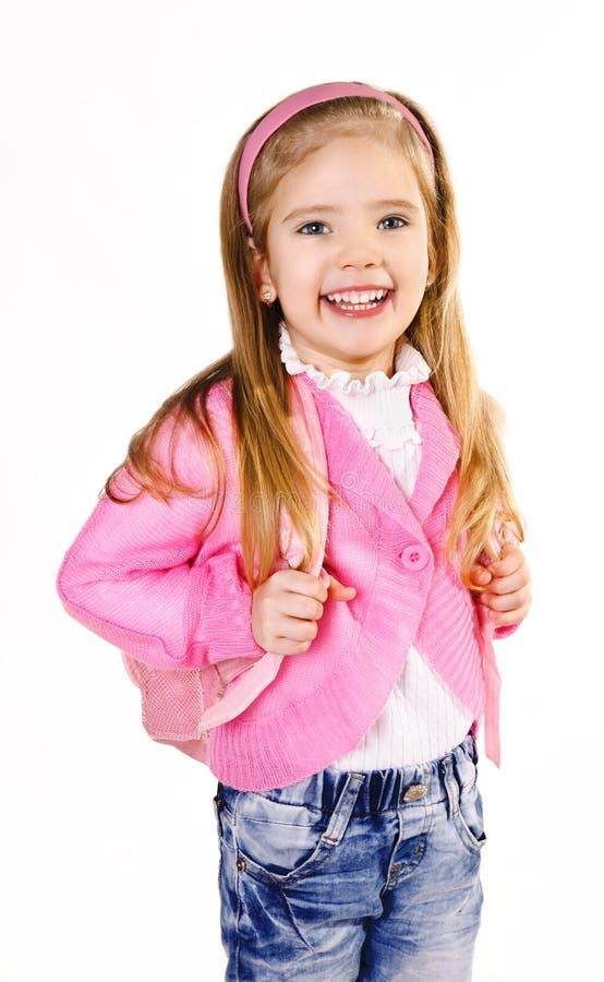 Glückliches kleines Mädchen mit dem Rucksack getrennt auf Weiß stockfoto