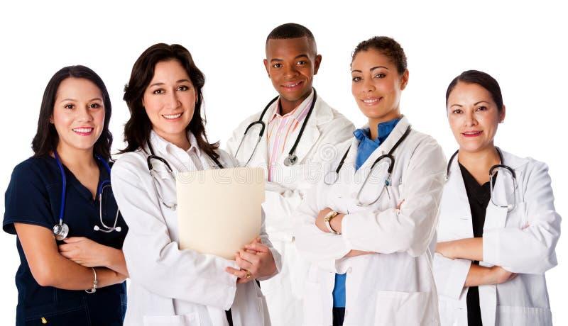 Glückliches lächelndes Doktorarzt-Krankenschwesterteam stockfoto