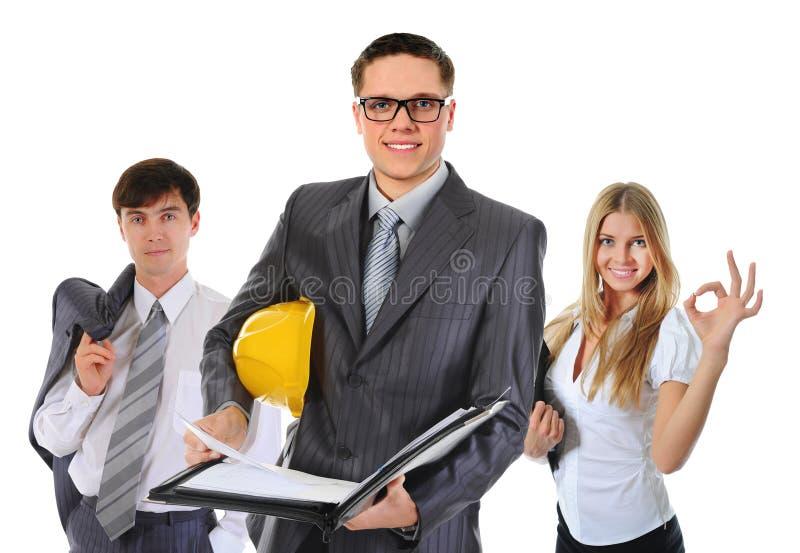 Glückliches lächelndes Geschäftsteam lizenzfreie stockbilder