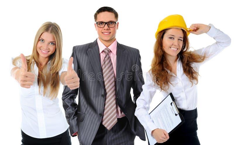 Glückliches lächelndes Geschäftsteam lizenzfreie stockfotos