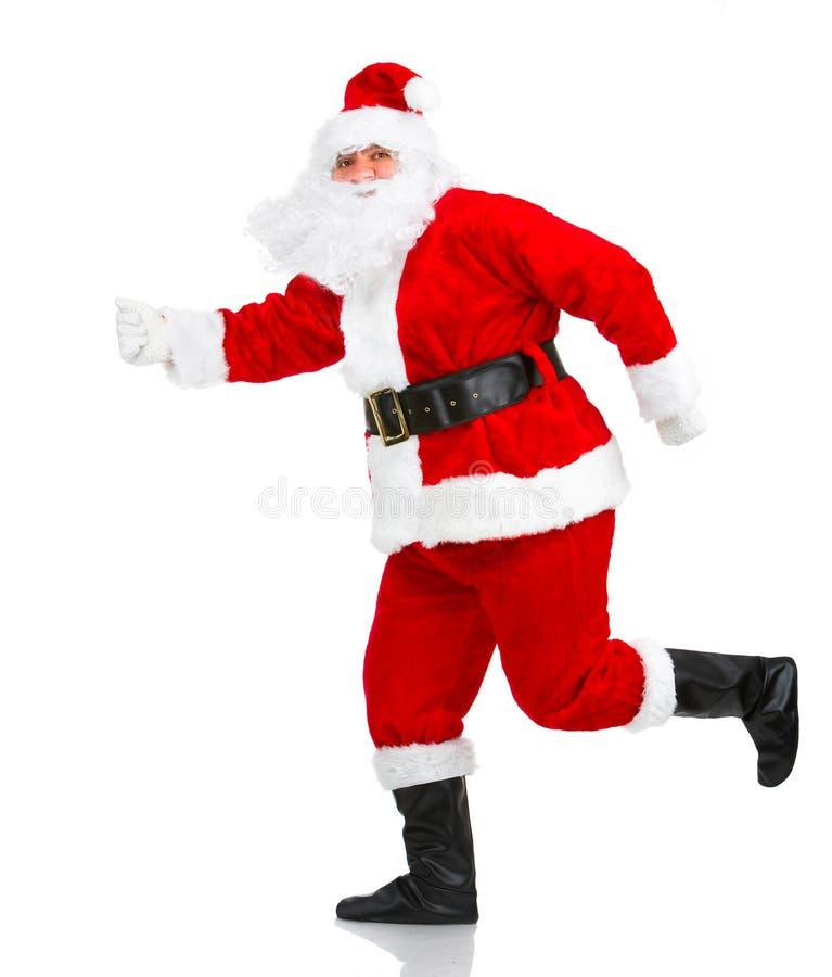 Glückliches laufendes Weihnachten Sankt stockbild
