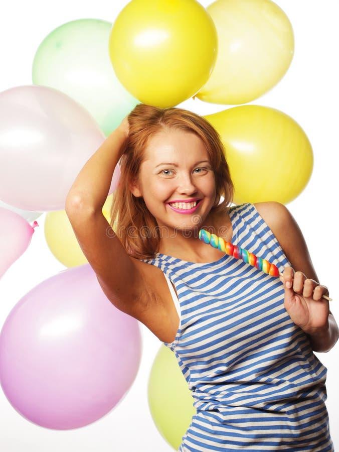 Glückliches Mädchen mit Ballonen stockbilder