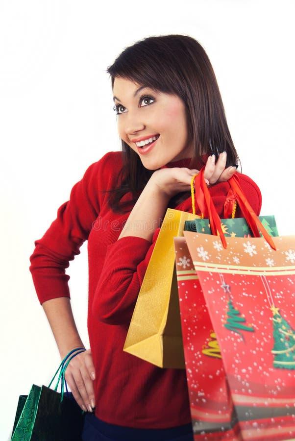 Glückliches Mädchen mit dem Weihnachtseinkaufen stockfoto