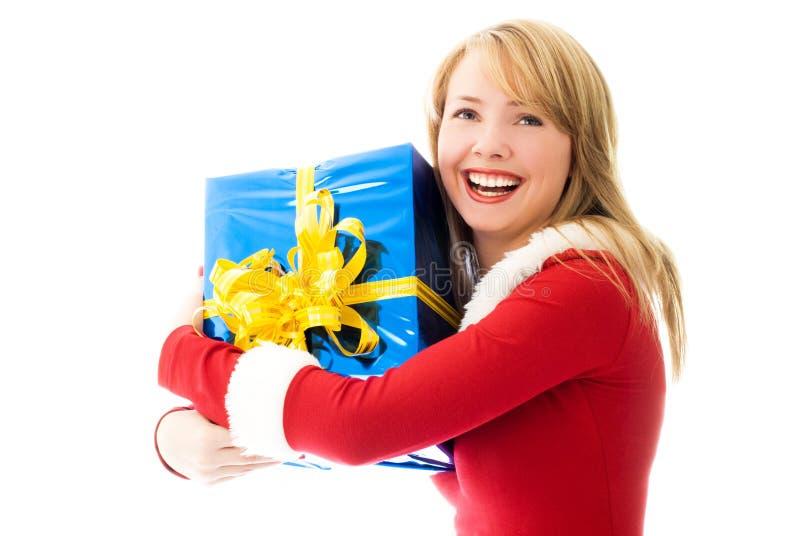 Glückliches Mädchen mit einem Weihnachtsgeschenk stockbilder