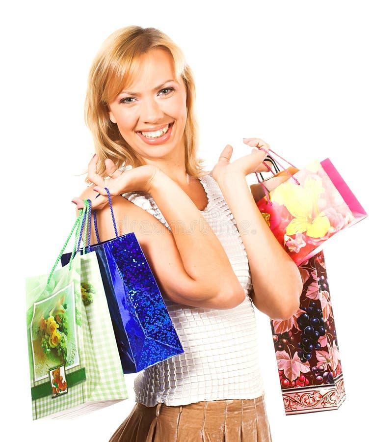 Glückliches Mädchen mit Einkaufenbeuteln lizenzfreies stockbild