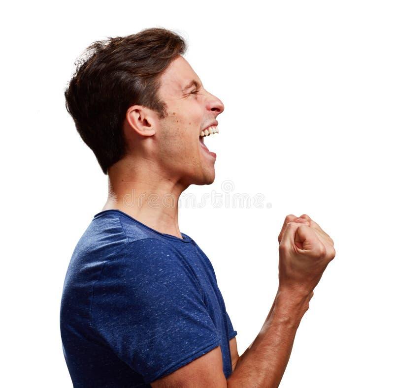 Glückliches Profil des jungen Mannes stockfotografie