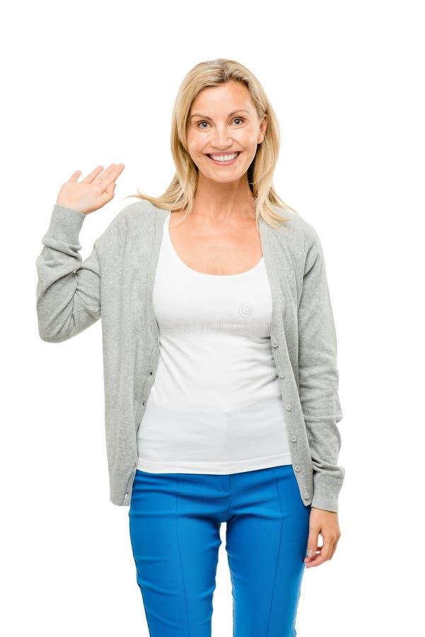 Glückliches reifes Frauenwellenartig bewegen lokalisiert auf weißem Hintergrund lizenzfreies stockbild