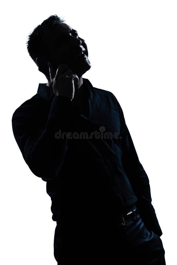Glückliches Telefon des Schattenbildmann-Portraits lizenzfreie stockfotos