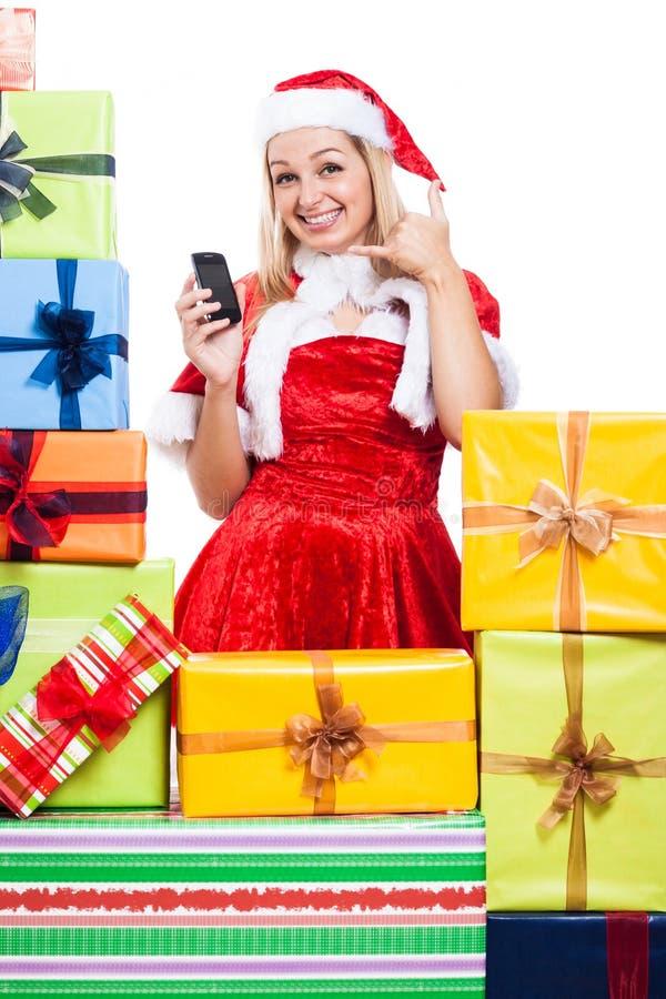 Glückliches Weihnachtsfrau, die geht, Sie anzurufen stockbilder