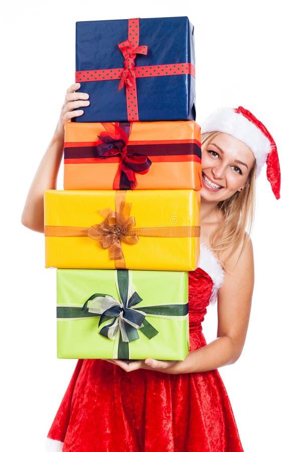 Glückliches Weihnachtsfrau mit vielen stellt sich dar stockbild