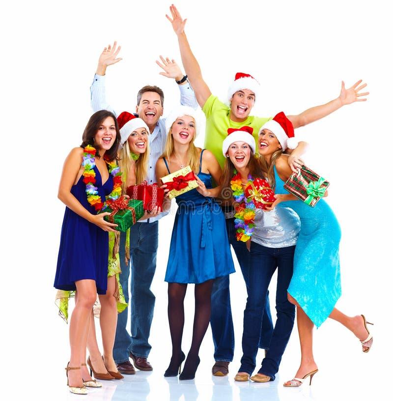 Glückliches Weihnachtsleutegruppe. stockfoto