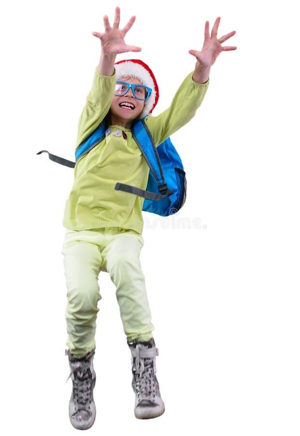 Glückliches Weihnachtsschulmädchen oder -reisender, die trainieren, laufen und springen stockfotografie