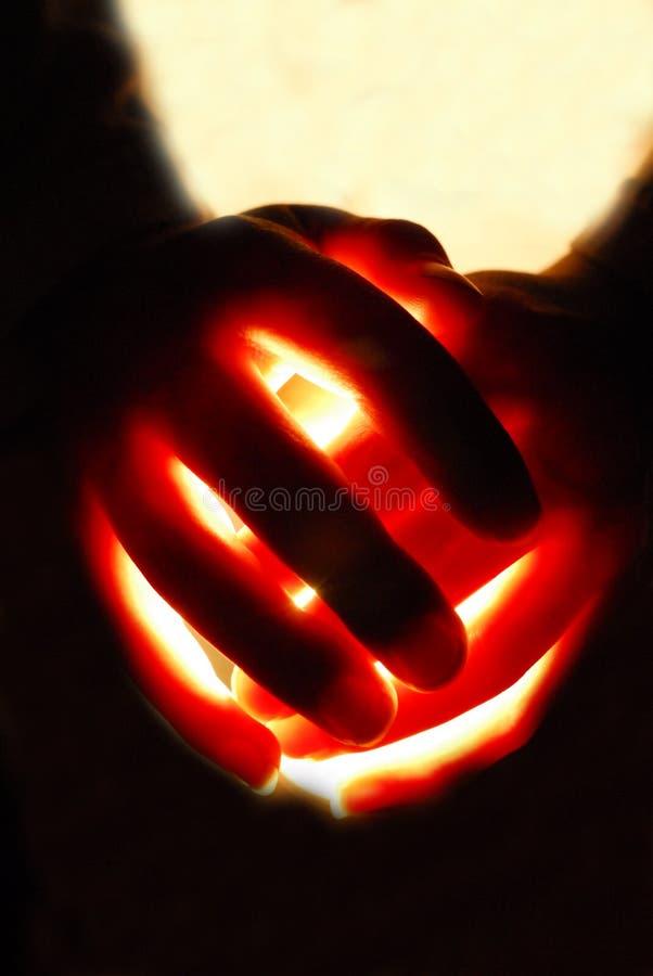 Glühende Hände lizenzfreie stockfotos