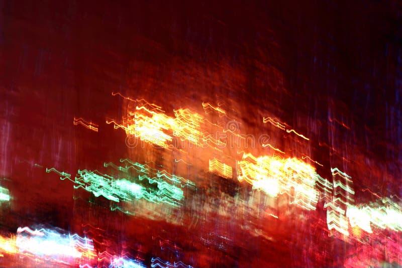 Glühende mehrfarbige Lichter in der Bewegungsunschärfe stockbild