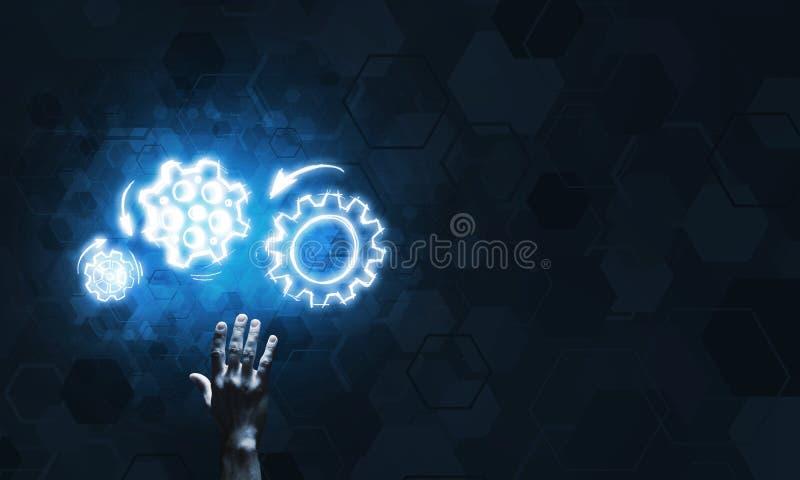 Glühende Zahnradmechanismusikone auf dunklem Hintergrund als Symbol der Teamwork lizenzfreie stockbilder