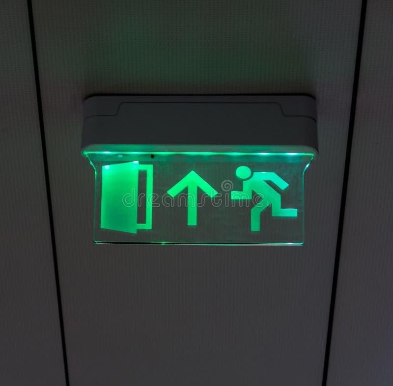 Glühendes Fluchtwegzeichen stockfotografie