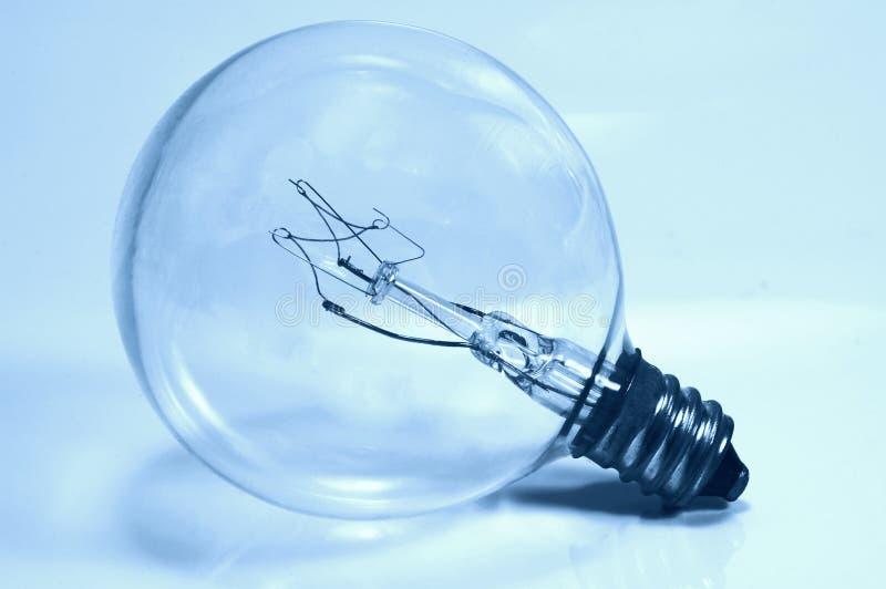 Glühlampe in Cyan-blauem stockfotos