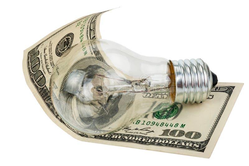 Glühlampebirne und -geld lizenzfreies stockfoto
