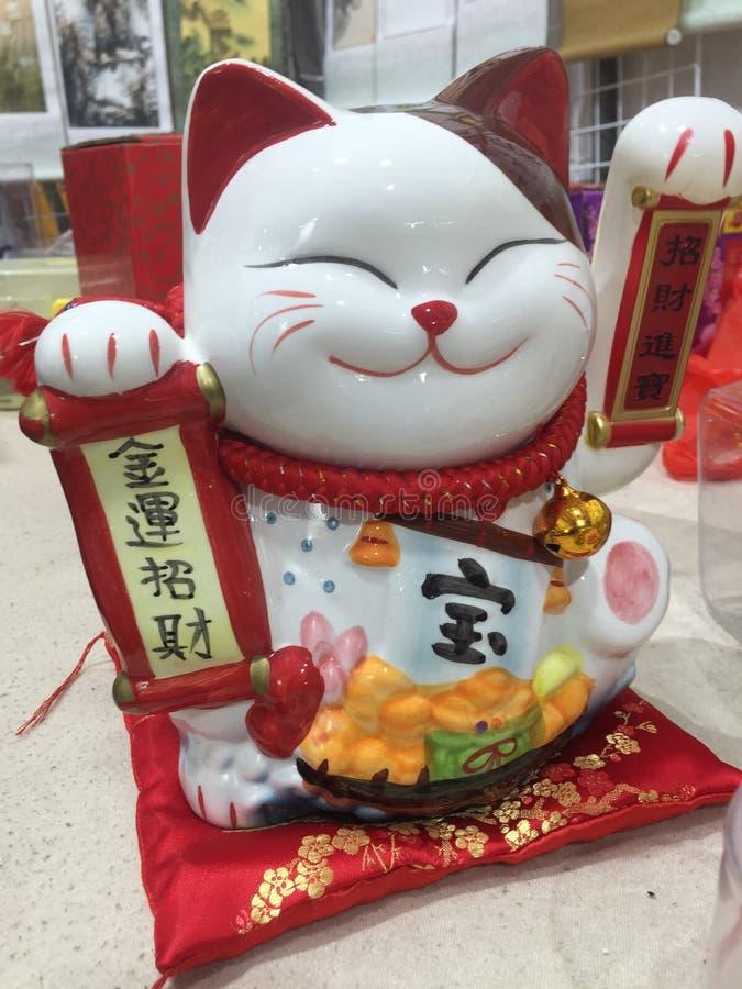 Gl?cksbringer, Talisman, maneki-neko, wellenartig bewegende Katze lizenzfreies stockbild